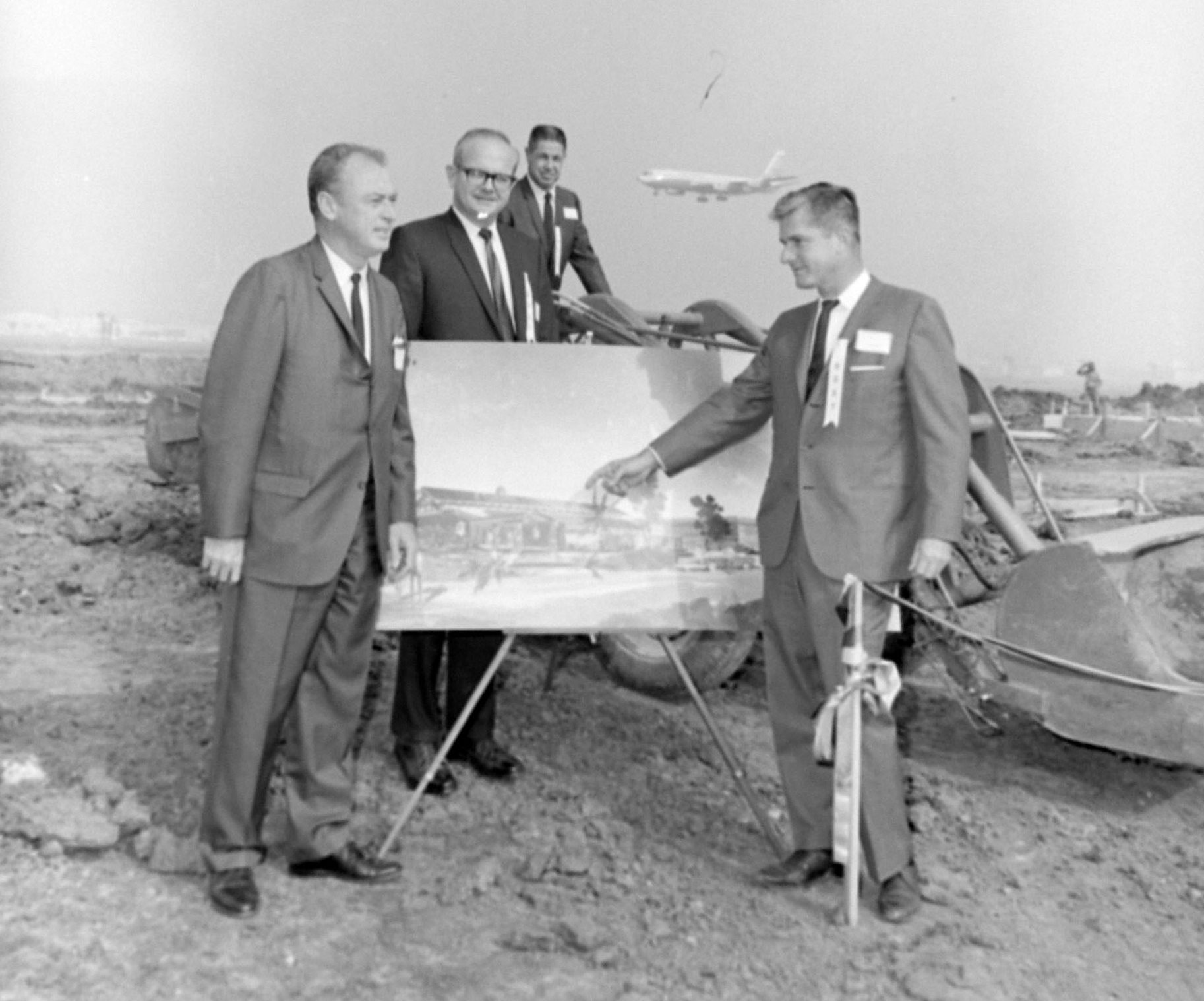 Groundbreaking for The Proud Bird restaurant near LAX, Oct. 15, 1966. Speciaty Restaurants owner David Tallichet, far right, points at an artist's rendering as, L to R, LAX manager Francis Fox, architect Kenneth Wing and Specialty VP David Perrin look on.